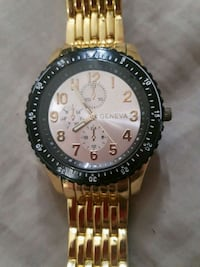round gold-colored Rolex chronograph watch with link bracelet 480 km