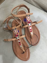 pair of brown leather sandals Coachella, 92236
