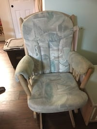 gray and green floral padded glider chair