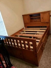 brown wooden bed frame with mattress College Station, 77845