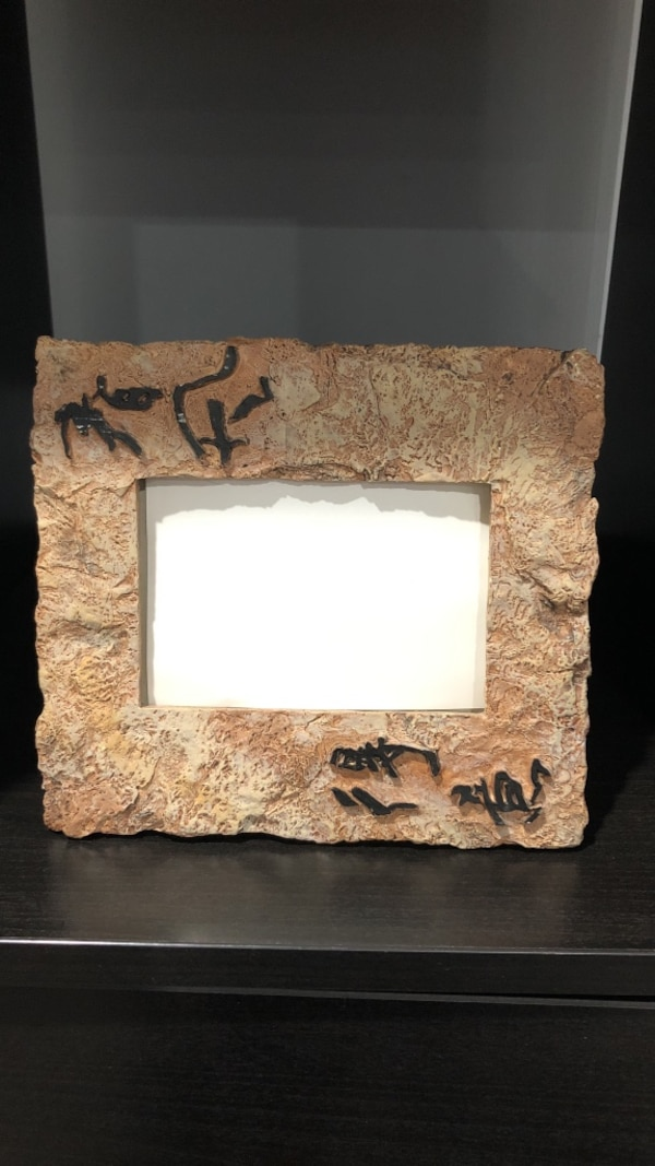 white and brown photo frame