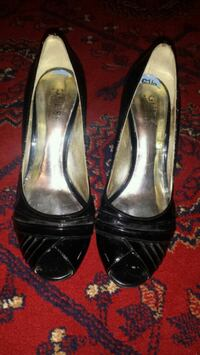 pair of black leather peep-toe heeled shoes