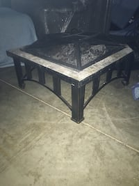 square black wooden framed glass top coffee table