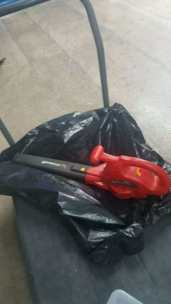 red and black string trimmer 65dd55ab-a83d-48e1-b906-1d045be48e7a