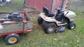 Riding mower and yard trailer.