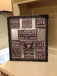 White text wall decor with black backgropund