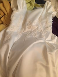 Classic wedding dress in like new condition.