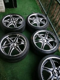 5 Rims with new tires 245-35-zr 20 Silver Spring