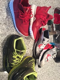 three pairs of assorted low-top sneakers