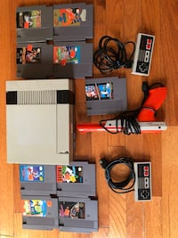 Nintendo NES console with controllers,Nintendo zapper and game cartridges Chantilly, 20151