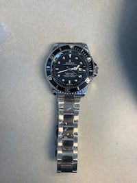 Luxury black and silver watch: not for free