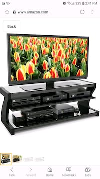 black flat screen TV with remote Vancouver, V5W 2H5