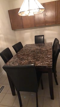 Rectangular brown marble top table with six chairs dining set Ottawa, K1K 4A4