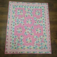 white, pink, and blue floral textile 1022 mi