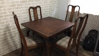 rectangular brown wooden table with four chairs dining set Abbotsford, V2S 3N4