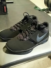 Size 9 pair of gray-and-black Nike sneakers