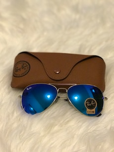 Silver and blue ray-ban aviator sunglasses with leather case