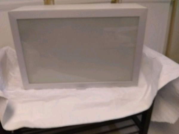 Brand new IKEA wall cabinet with glass door d7b882b7-0ab4-43e6-952c-2420e2a33f2f