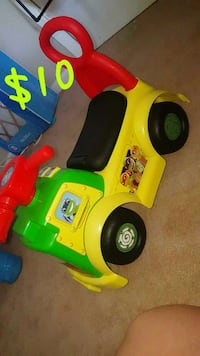 children's yellow, red, and green push car Hughes Springs, 75656