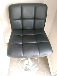 gray leather padded rolling chair