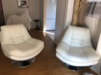 Two white leather chairs. The price is for each  2268 mi