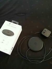 black Mophie wireless charger with boxd 561 mi