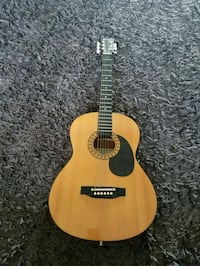 brown and black acoustic guitar Frederick, 21703