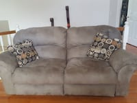brown suede loveseat with two throw pillows Orlando, 32837