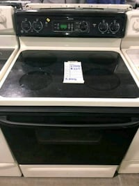 GE BISQUE AND BLACK GLASS TOP 220VOLTS STOVE $219  Hempstead, 11550
