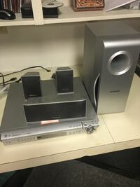 gray and black home theater speaker system