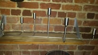 two stainless steel and brown bar stools