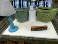 white and blue table lamp with two green woven baskets