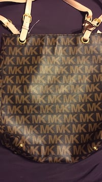 brown and black Michael Kors leather tote bag