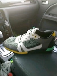 unpaired white and green Nike basketball shoe Tacoma, 98408