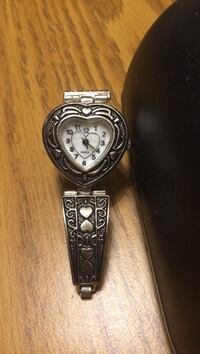heart shaped silver analog watch with