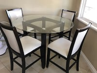 Black wooden table with glass top and chairs dining set Lake Forest