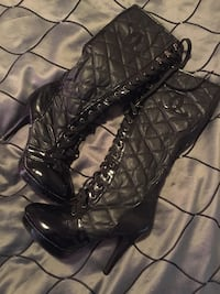 Pair of black leather lace up boots  Kitchener, N2M 2L2