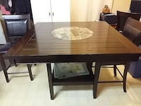 square brown wooden table and 5 chairs 7 months