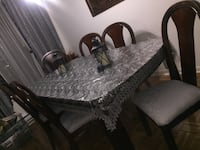 rectangular brown wooden table with six chairs dining set Montréal, H2T 2E5