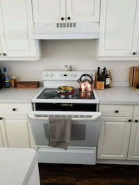 white and brown wooden kitchen cabinet Pensacola, 32514