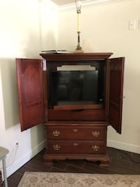 brown wooden TV hutch with flat screen television Tallahassee, 32308