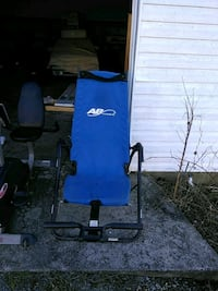 blue and black AB Lounge inversion table 58 km