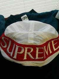 white and red Supreme cap Portland, 04102