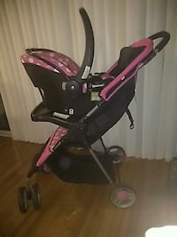 baby's black and pink stroller