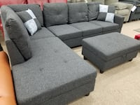 Black gray linen sectional with ottoman and pillows College Park