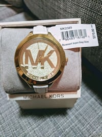 round gold Michael Kors analog watch with gold lin Vancouver, V5L 3A1