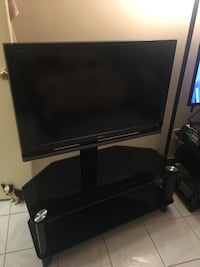 black flat screen TV with remote New York, 11230
