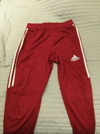 red and white adidas track pants 548 km