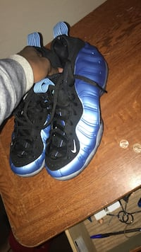 pair of black-and-blue Nike Foamposite