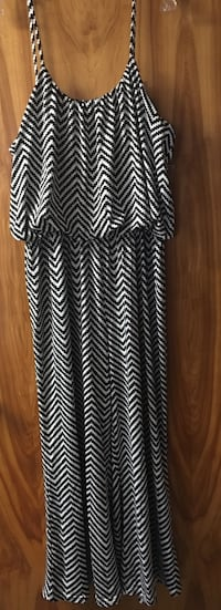 Black & white one piece pant suit w/adjustable top straps. Size 1x. Only worn one time!!!